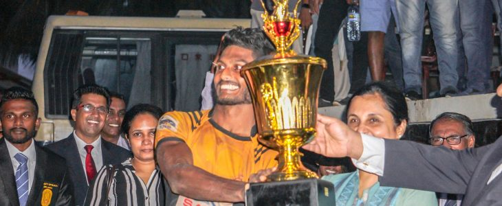 Krishmal Fernando with the trophy