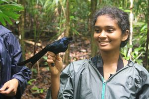 Ms. Warunika holding a drongo bird.